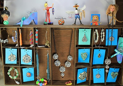Altered art jewelry display I made to hang on the wall of my booth. Cup hooks hold all the jewelry inside of the 3 altered art jewelry displays.