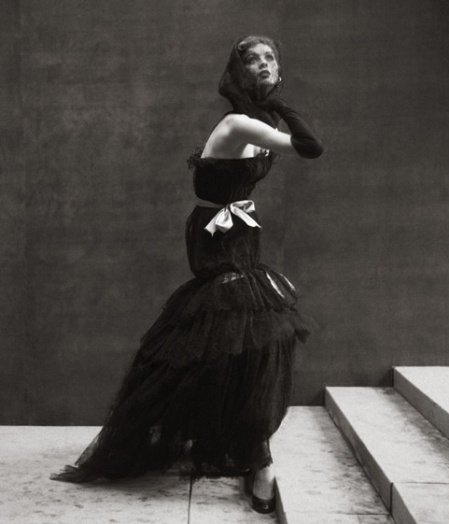 Suzy Parker in Balenciaga's evening dress of black lace and ribbons inspired by the majas of Goya, photo by Richard Avedon, Harper's Bazaar, Oct. 1952