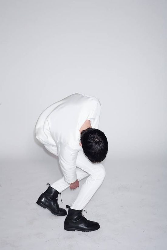White outfit with black shoes.