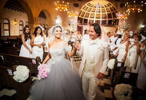 #RHOM wedding joy! We've got exclusive pics from Real Housewives of Miami star Adriana De Moura's elaborate wedding to Frederic Marq. Click through for details on the ceremony, reception, and more!