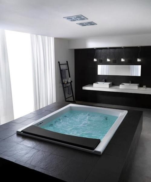 Super duper luxury - add a splash of colour and a sound system with gentle, relaxing music is what I would do, pop a few candles around the bath area and I'm ready to enter into deep relaxation!