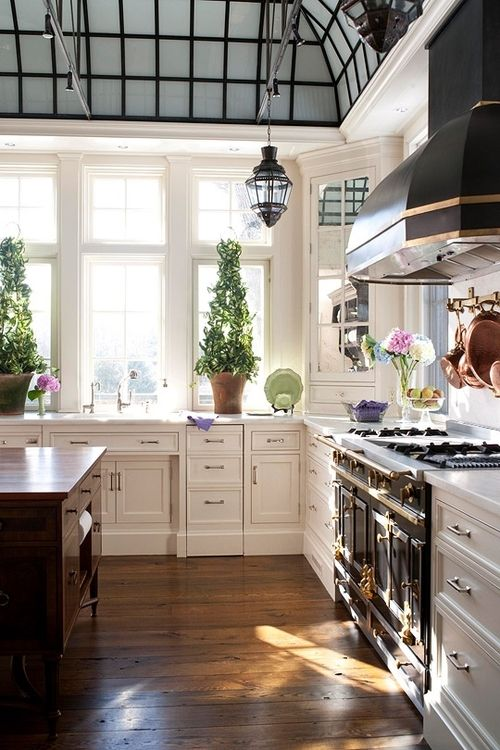 BEAUTIFUL kitchen...love the Stove Range & Hood, the gorgeous ceiling, lovely windows, love the dark wood island in contrast to the beautiful white cabinetry, etc....