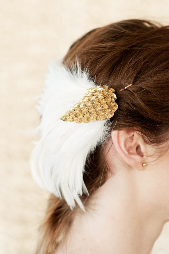 feathered hair accessory  Photography by jelphoto.co.nz, hair accessory from www.thelittlewhit...