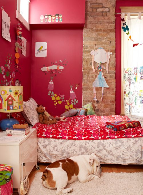 So many things make this room perfect: Color, Cut-out art on the walls (especially the large one on the bricks), Cute lampshade, even the dog!