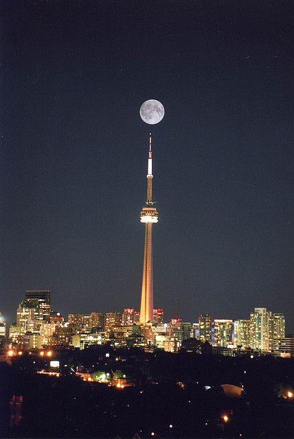 full moon over CN Tower, Toronto, Canada