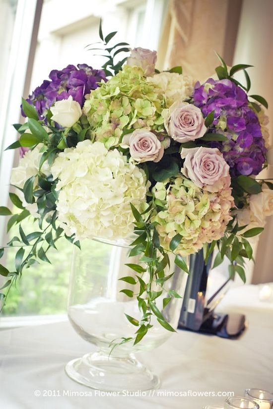 purple flower arrangements centerpieces