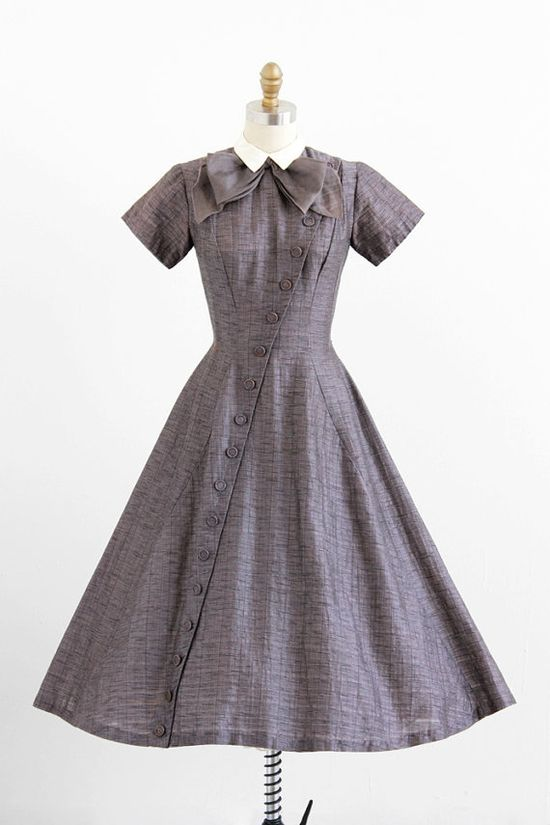 vintage 1950s grey schoolgirl dress with buttons + a pussy bow.