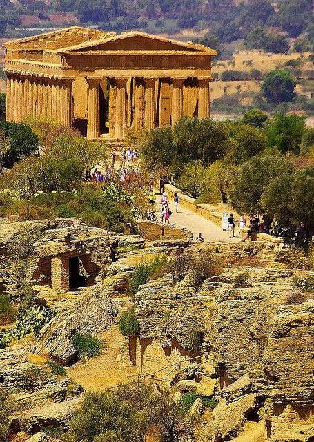 Temple of Concord, Agrigento - Sicily .... the most intact ... (440 BC-430 BC).  The Valle dei Templi (English: Valley of the Temples, Sicilian: Vaddi di li Tempri) is an archaeological site in Agrigento (ancient Greek Akragas), Sicily, southern Italy. It is one of the most outstanding examples of Greater Greece art and architecture, and is one of the main attractions of Sicily as well as a national monument of Italy. The area was included in the UNESCO Heritage Site list in 1997.