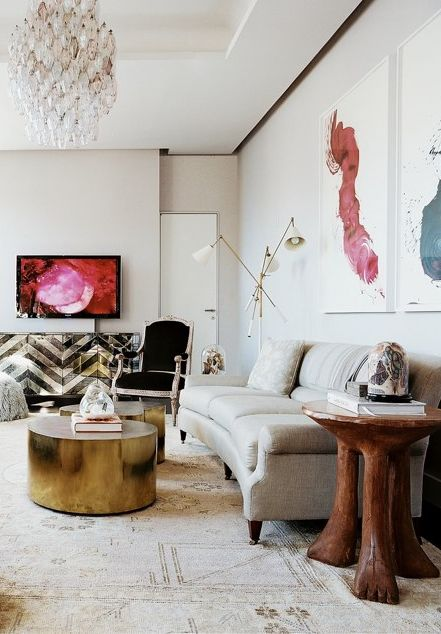 I love all of the glamorous pieces in this living room.