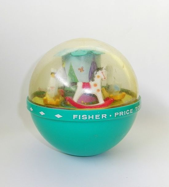 Fisher Price Musical Chime Ball  Vintage Fisher Price Musical Chime Ball- One of the popular Fisher-Price toys that was made for nearly 3 decades is the Roly Poly Chime Ball.