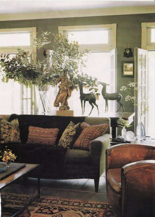 Masculine living room with green walls - love it