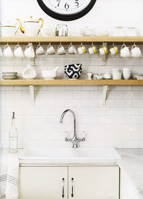 Wise use of open shelves in a kitchen. Photo by Lisa Cohen