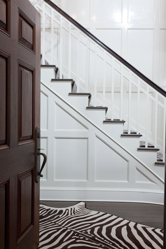 Dark wood with white, simple moldings