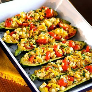 Zucchini stuffed with savory onion, yellow squash, ripe tomatoes and crumbled feta cheese. Makes for an impressive vegetable side dish--or two servings make a healthy vegetable entree.