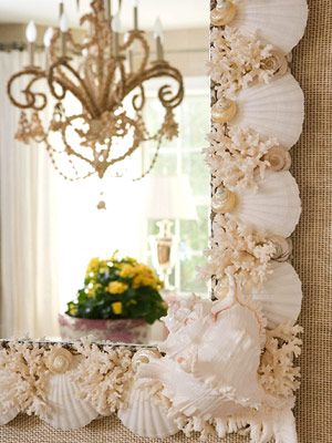 Pretty mirror, corral and white shells and snails! ideas! Love this