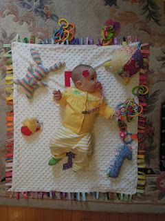 I love this minky blanket with rainbow ribbon tabs!  These are all homemade baby toys too!
