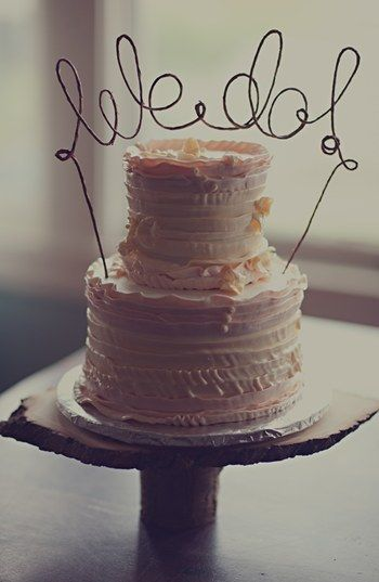 "Think about adding a rustic cake topper to your wedding cake. This ""We Do"" topper can be found at #Nordstrom."