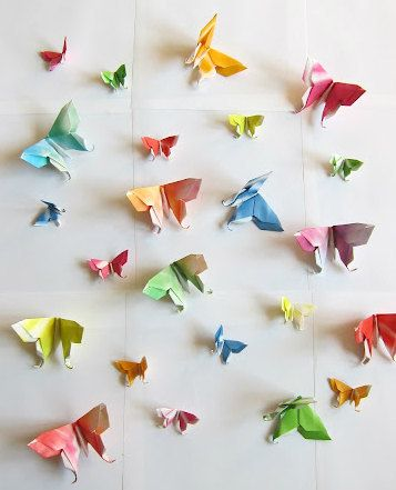 origami butterflies pinned to the wall