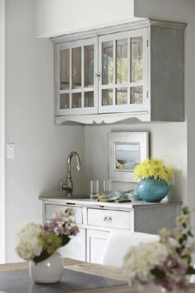 Grey kitchen cabinets and grey walls