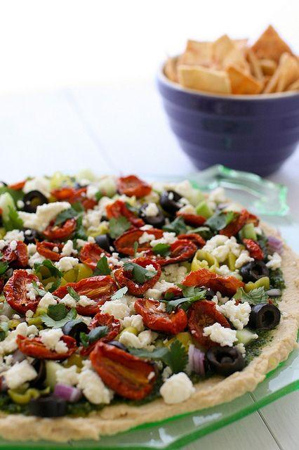 Hummus layer dip with cilantro pesto.