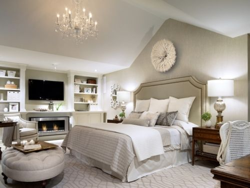 round tufted ottoman, wall color, carpet pattern, high headboard & paint color, tall lamps, touches of wood for contrast, built-ins