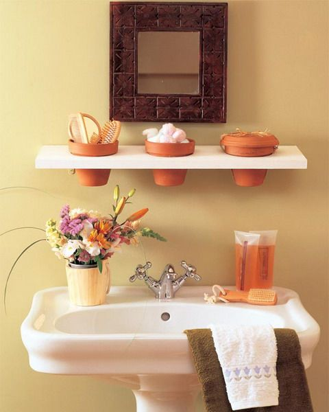 Here is a list of 31 creative storage and organization Ideas for a small bathroom. This one in the photo is a lovely and quirky idea. Most of this list is creative ways to do shelving and storage containers, but it's still a good list.