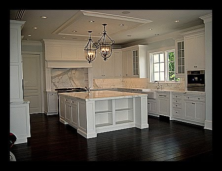 love this kitchen!!!!!!! love the contrast between the white cabinets and the dark espresso floors!
