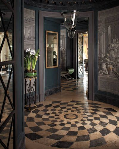 A rotunda with 18th-century trompe l'oeil wallpaper panels, tiled floor, great lantern, glass door and paper whites. Frederic Mechiche, designer