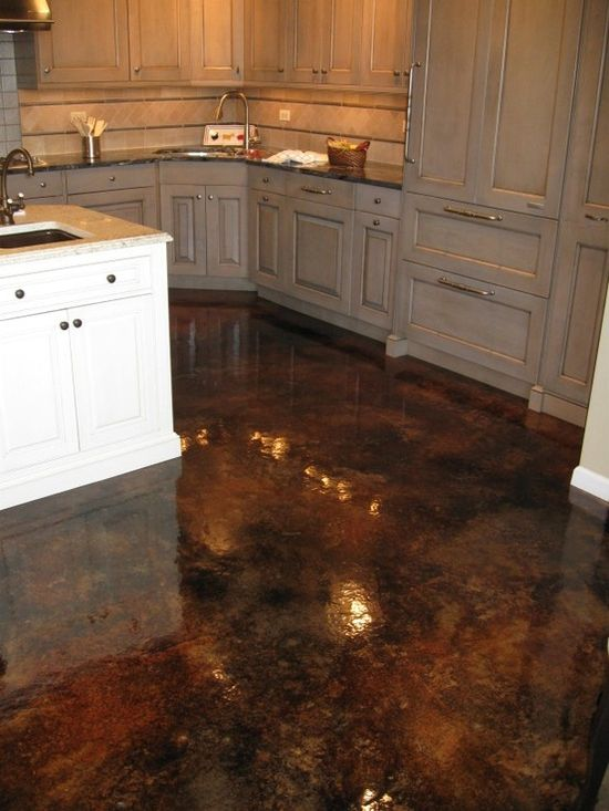 Acid stained concrete flooring with gloss finish. So easy to clean & goes with hardwood floors in the rest of house, plus NO GROUT!!
