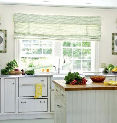 Vintage charm meets modern efficiency in this cottage kitchen with an apron-front sink and beaded-board island. Myhomeideas.com