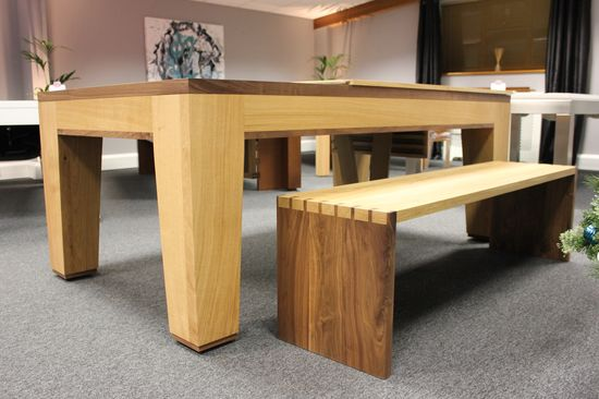 A contemporary dual purpose pool/dining table in Oak and American Black Walnut. Handmade with traditional mortice and tenon joints and matching dovetailed bench. www.designerbilli...