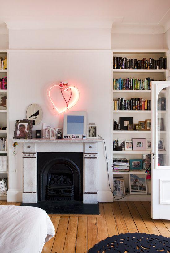 bedroom w/ fireplace + bookshelves