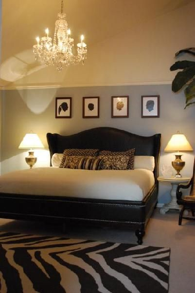 love the bed and silhouettes above the bed....