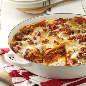Quick Dinner! One Skillet Lasagna Recipe from Taste of Home -- This is hands-down one of the best skillet lasagna recipes our testing panel has ever tasted - and definitely kid-friendly.  #Lasagna