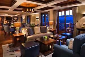 Experience the warmth of resort's ambiance as you take in scenic views of the Vail Valley from the Club Lounge at The Ritz-Carlton, Bachelor Gulch.
