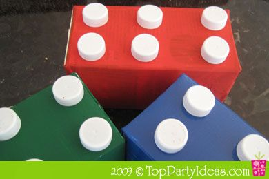 Lego Party Centerpiece using Recycled Milk Cartons  Here is another inexpensive party decoration idea for your Lego Party without spending too much money and the best part is, these gigantic mock Lego blocks are created out of recycled milk cartons and milk carton caps!  Great for Lego or Duplo parties for kids and adults of all ages.  Lego Party Supplies #LegoDuploParty