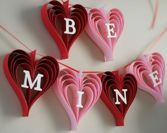 Be Mine Valentine's Day Banner of hand cut hearts.
