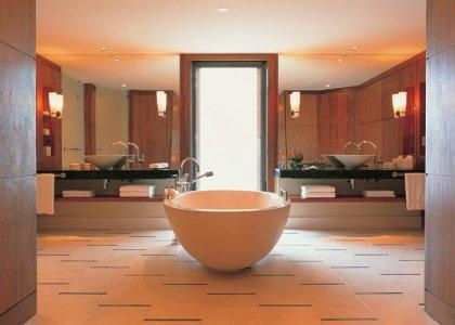 His and hers bathroom fittings at Le Touessrok, Mauritius, with a big bath for two of course