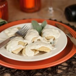Handmade ravioli filled with a savory ricotta and pumpkin mixture, topped with a deliciously cream sage sauce.