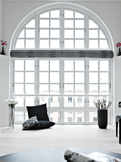 Magnificent arch window. Simple & elegant decor.