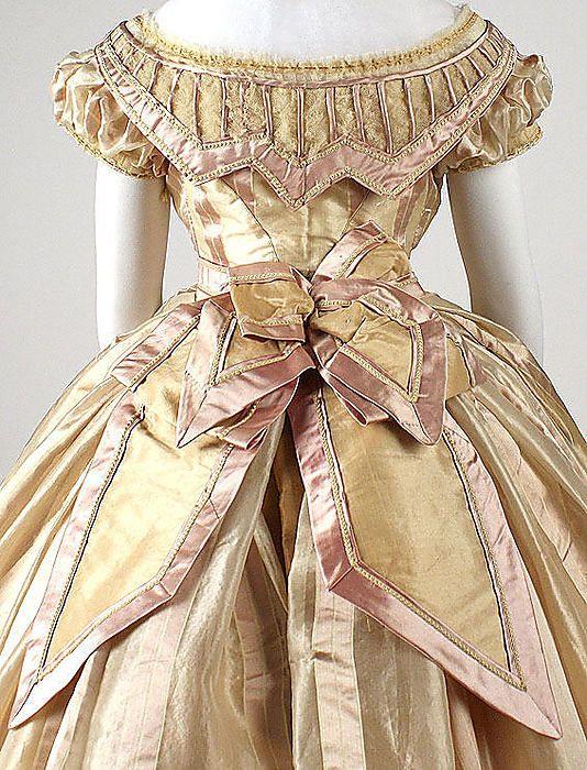 "Gold silk dress (back detail, evening bodice), French, ca. 1865. Label: ""Mme. Marguerite Robes, 6 rue de Miromenil, Paris"""