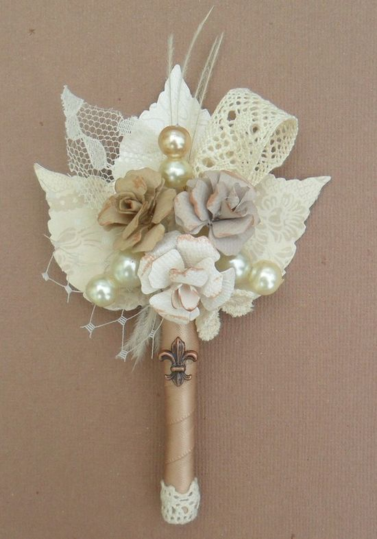 boutonniere with lace and pearls- I would probably sub the fake flowers for berries or feathers and the white leaves for burlap...love this idea of not having real flowers though!!