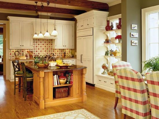 This makes me happy :)  I love the combination of the rich, warm colors, exposed beams, and the beautiful cabinetry.  Yum.