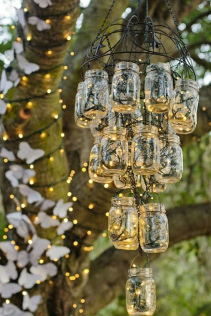 Love this mason jar light fixture at this outdoor wedding.