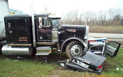 Police car ran over by semi truck