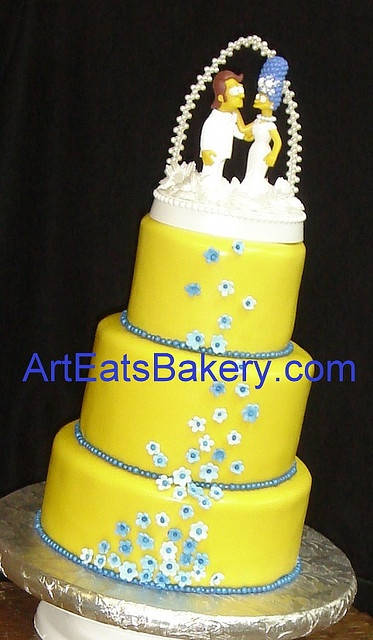 Simpsons yellow fondant wedding cake with Marge and Homer topper by arteatsbakery, via Flickr