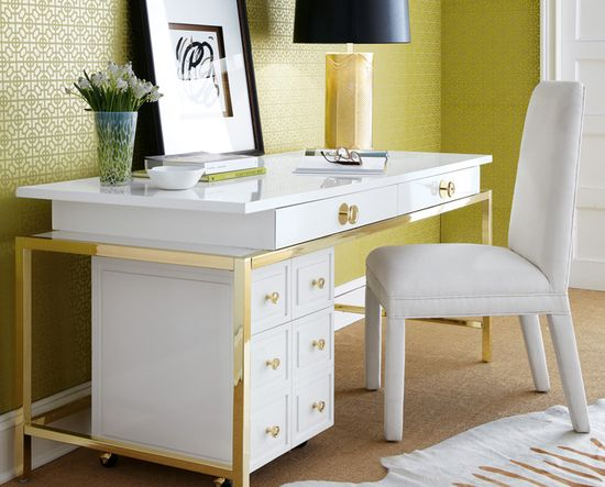 contemporary + elegant.  modern desk with gold detail, slipper chair, and graphic metallic wallpaper.