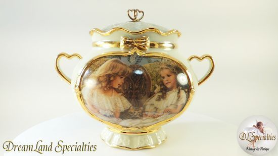 FREE $25 Gift Certificate with $25 or more purchase!  DreamLand Specialties is pleased to be able to offer exceptionally fine heirloom treasures that are perfect for gift giving or any collection.   Offering: Best Friends Memories Gold Guilt Porcelain Music Box       Product