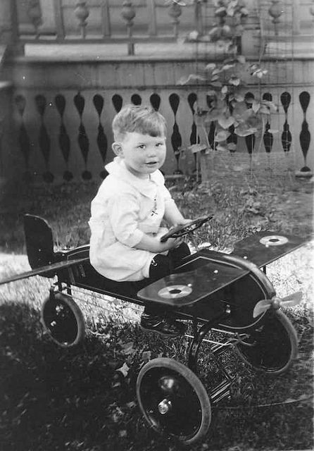 American Boy with toy airplane (1920s)