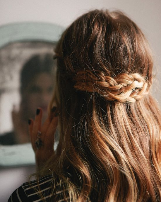 perfect perfect beach hair, a soft wave with golden highlights, held back by a casual braid